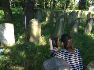 Recording matzevah using mobile data collection (Photo credit: Dr Caroline Sturdy Colls)