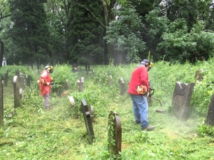 Cutting the grass in Oswiecim Jewish Cemetery (Photo credit: Dr Caroline Sturdy Colls)